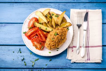 Mozzarella-Crusted Chicken with Blistered Tomatoes and Potato Wedges